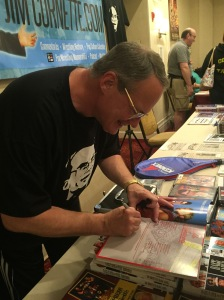 Cornette signing his Midnight Express 25th Anniversary scrapbook (must read).