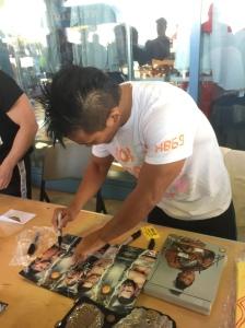 KUSHIDA signing